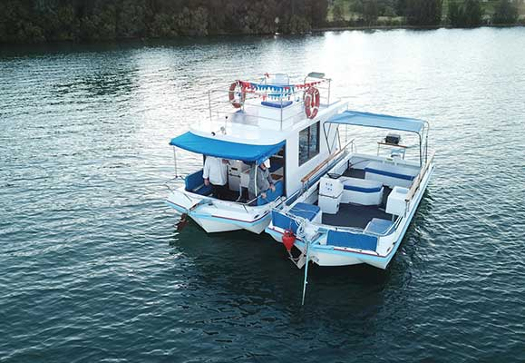 top of the lake boat hire 21' enclosed and open day boat for hire
